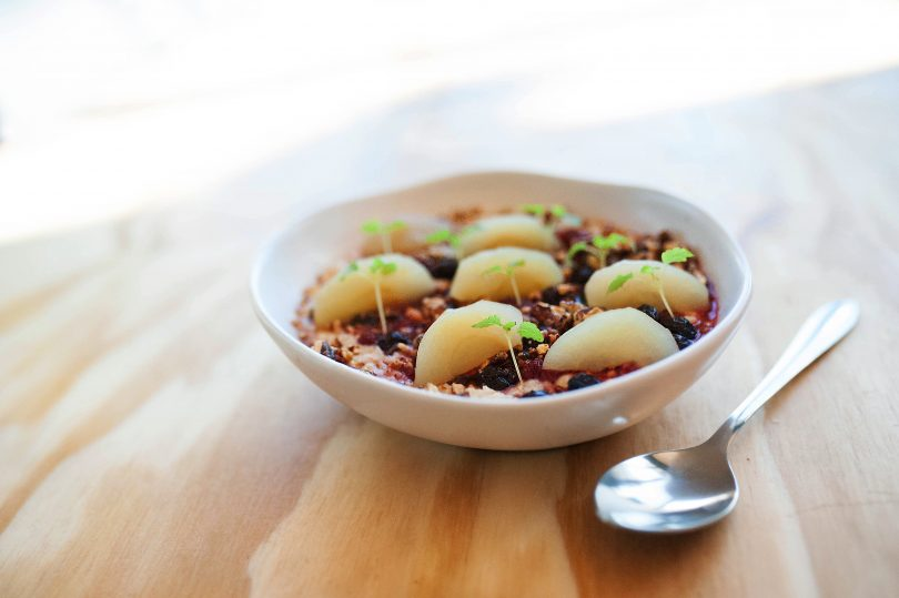 The winter porridge is a generous bowl of coconut porridge, mixed berry compote, caramelised pecan and candied apple.